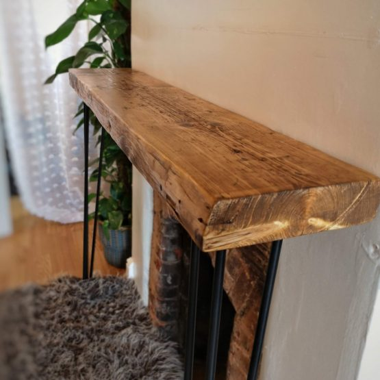 a side profile rustic wood console unit above fireplace