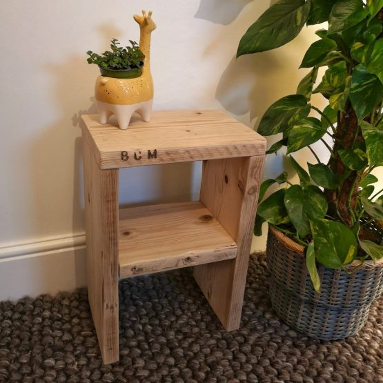A little reclaimed timber side table with an ornament on