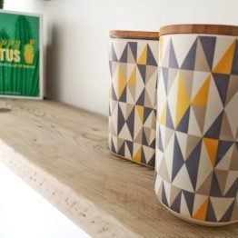 two tins on a rustic wood shelf