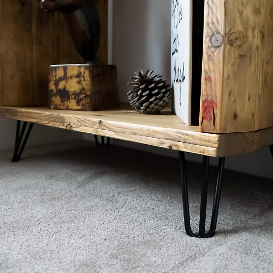 A rustic reclaimed wood record player vinyl unit front close up with hairpin legs