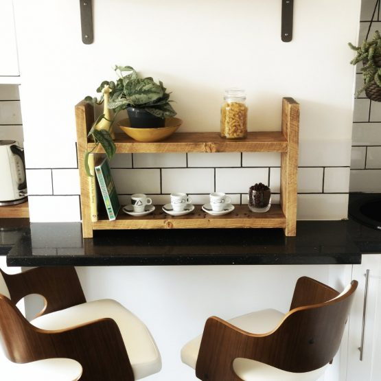 A rustic countertop unit with coffee beans on